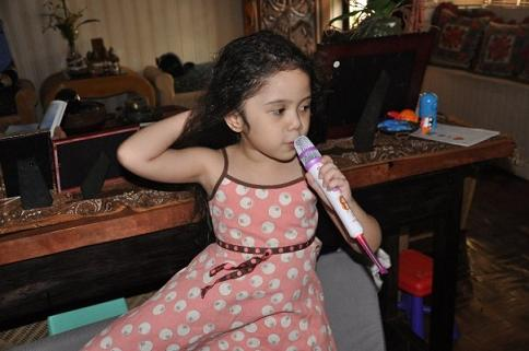 My niece, Ishi, doing one of her favorite hobbies - singing!