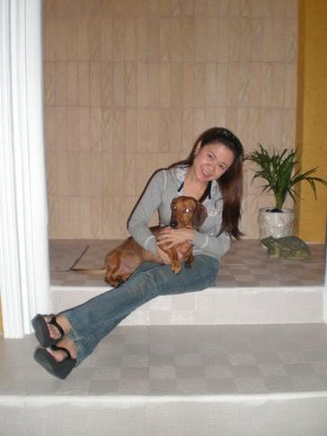 My sister, Neriz, with one of her two dachshunds (Duke)
