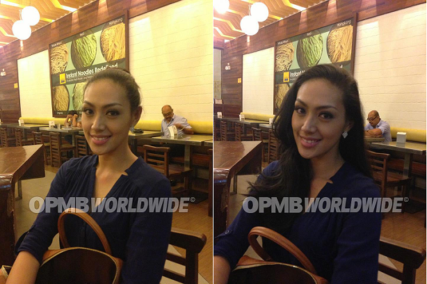 How do you like Shan Apuad's hair? Pulled back and clipped on a bun or free-flowing?