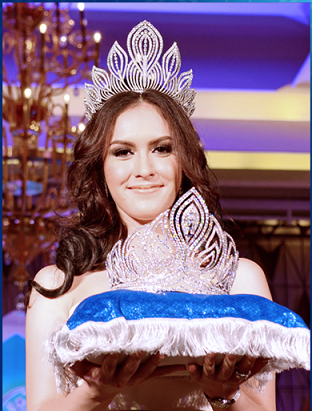 Miss Universe Thailand 2012 Farida Waller offers the crown for this year's winner.