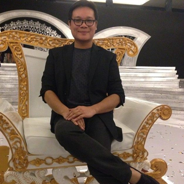 Jonas Gaffud sitting on the Miss World 2013 throne.