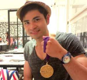 Reygor showing off his WCOPA medal