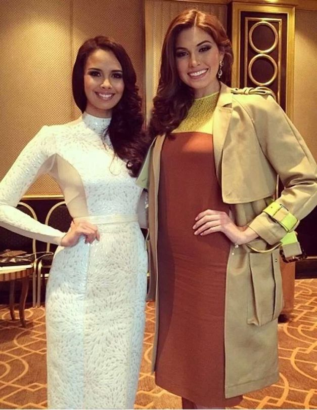 Miss World 2013 Megan Young (left) and Miss Universe 2013 Maria Gabriela Isler meet in Moscow.