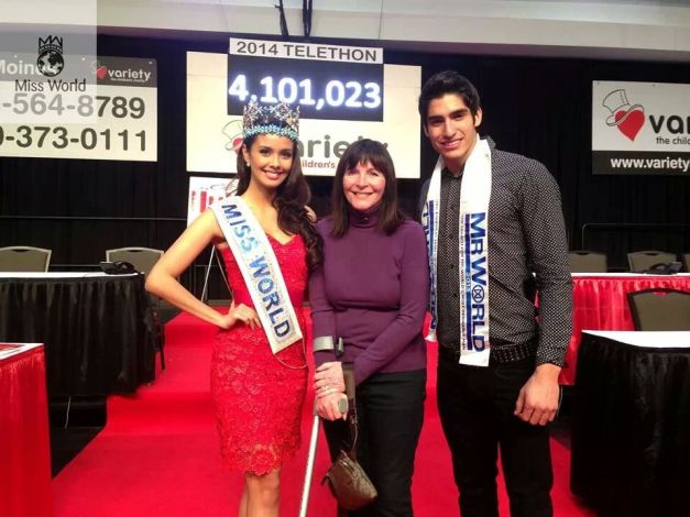 Julia Morley (middle) is seen being flanked by Miss World 2013 Megan Young (left) and Mr. World 2012/13 Francisco Javier Escobar Parra during a telethon in Iowa which raised more than USD4Million in pledges and donations.