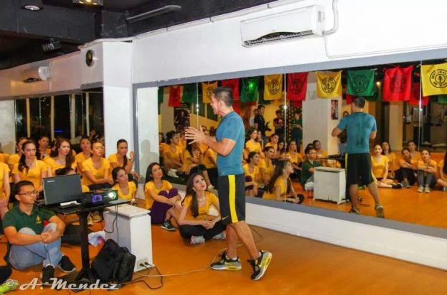 Fitness Guru John Cuay giving the ladies a lecture on health, diet and exercise.