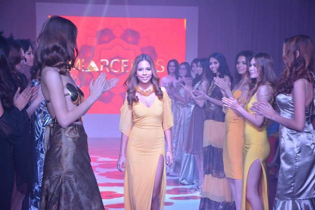 Mia Arcenas (middle) during the fashion show featuring the MIARCENAS Spring/Summer 2014 Collection