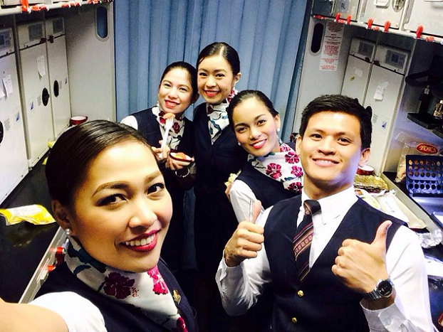 Maine (2nd from right) on the job with fellow PAL Flight Attendants
