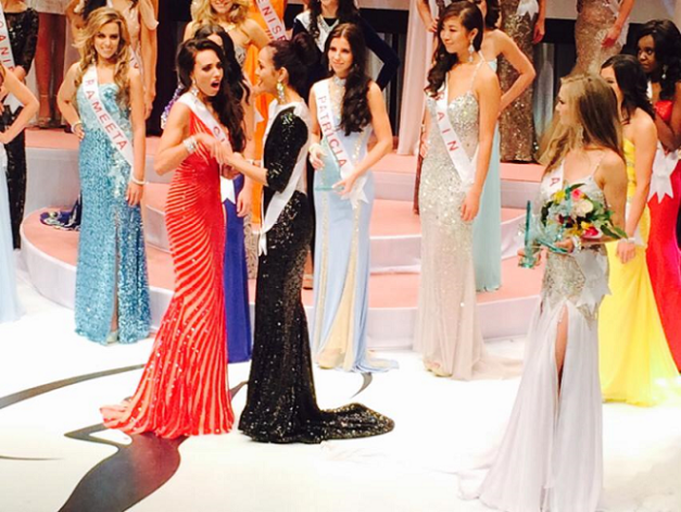Chanel Beckenlehner (left in red) won Miss Universe Canada 2014 with Kesiah Papasin (in black) placing 1st Runner-Up (Photo credit: Edgar Sulit)