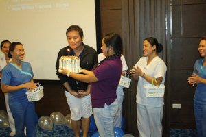 Jonas Gaffud (center) blowing his birthday cake brought in by the staff of Bluewater Day Spa.