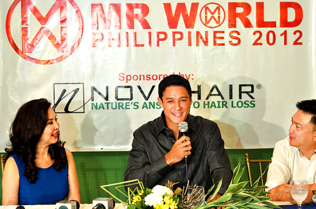 Mr. World Philippines 2012/13 and Mr. World 2012/13 1st Runner-Up Andrew Wolff during his media presentation as rep to the male pageant two years ago. Ms. Cory Quirino (left) and Arnold Vegafria flank him.