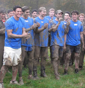 Andrew (leftmost) getting literally down and dirty for the team challenges