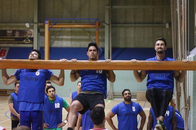 John (leftmost) being tested for upper body strength.