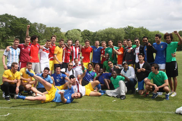 The Mr. World 2014 candidates during the Football Challenge won by Mr. Peru (front, lying down and wearing white shirt with a big maroon stripe in front).