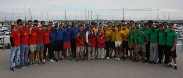The four (4) color-coded teams pose for a group shot after the Sailing Challenge.