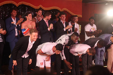 The Mr. World 2014 talent finalists taking a bow.