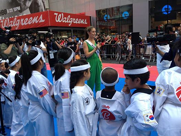 Miss USA 2014 Nia Sanchez doing a talk to the Tae Kwon Do Education Foundation at the Times Square Children Festival