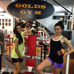 Yvethe (left) and Bianca during a break in gym training with John Cuay.