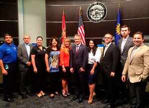 Doral Mayor Luigi Boria (6th from left) actually jumped the gun on Donald about hosting MU2015.