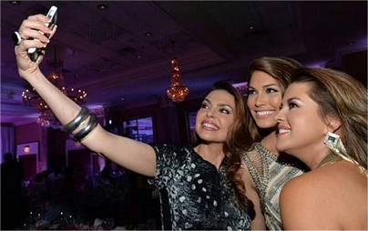 Three Miss Universe winners and a selfie, er, groupie