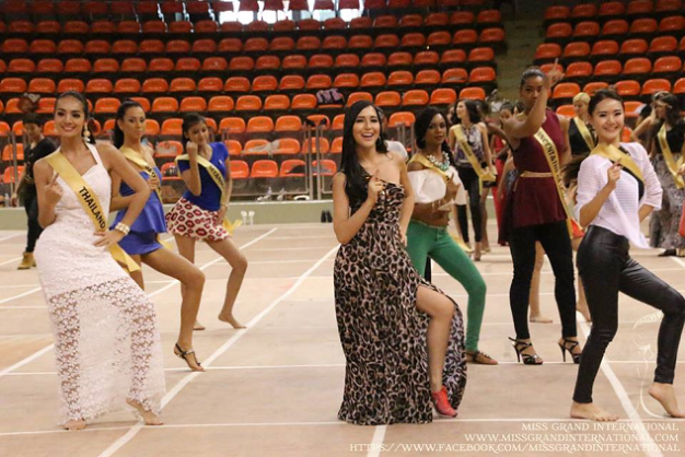 Miss Philippines Kimberly Karlsson (center, in printed dress) practices the opening number with the other ladies of MGI2014
