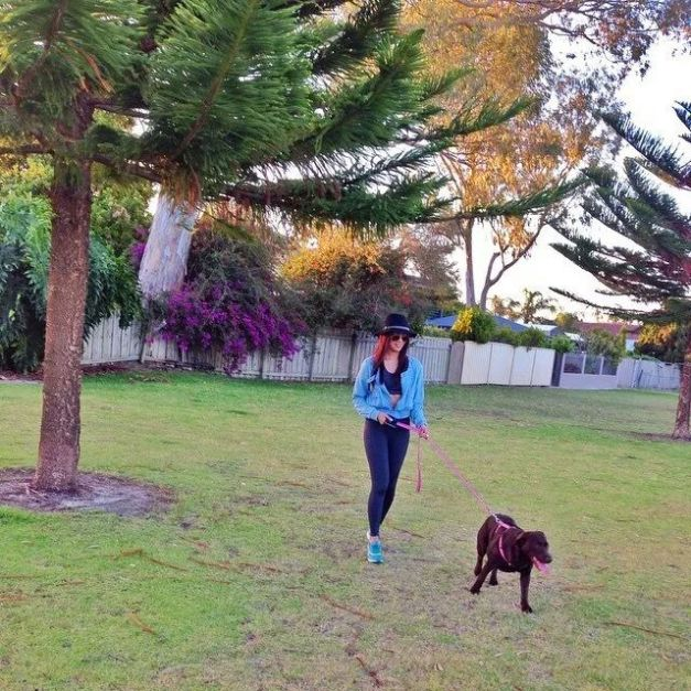 Ara walking the dog, Bailey, in eye-catching style.