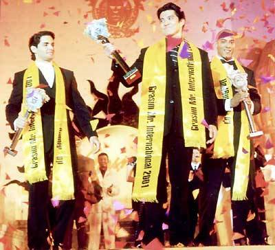 Left to right: 1st Runner-Up Anibal Martignani Pérez of Venezuela, Mister International 2001 Alexander Aquino of the Philippines and 2nd Runner-Up Leroy Vissers of Holland