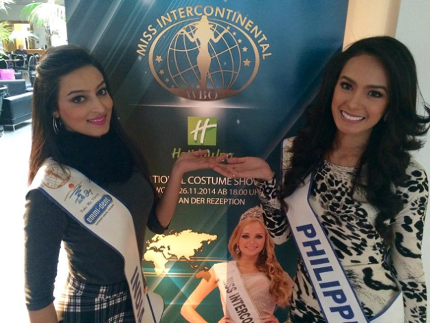 Roomies Miss Philippines Kris Tiffany Janson (right) and Miss India Sharma Chandni pose in front of a Miss Intercontinental 2014 standee.