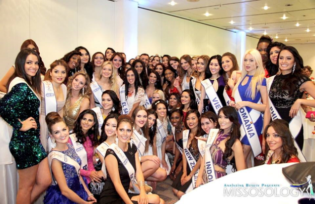 Miss Philippines Kris Tiffany Janson (standing, rightmost) pose with the other delegates.