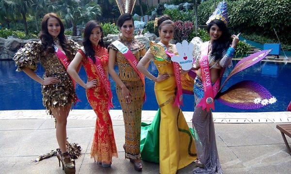 Miss Philippines Glennifer Perido (1st from left) in her National Costume (by Eric delos Santos) for Miss Tourism International 2014/15.