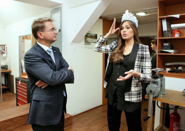 DIC Chairman of the Board Lubos Riha (left) with Miss Universe 2013 Gabriela Isler who is fitting a crown on her head.
