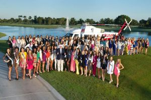 The 88 members of Miss Universe Class of 2014-15 pose with Donald Trump (in cap, blue blazer and white pants).