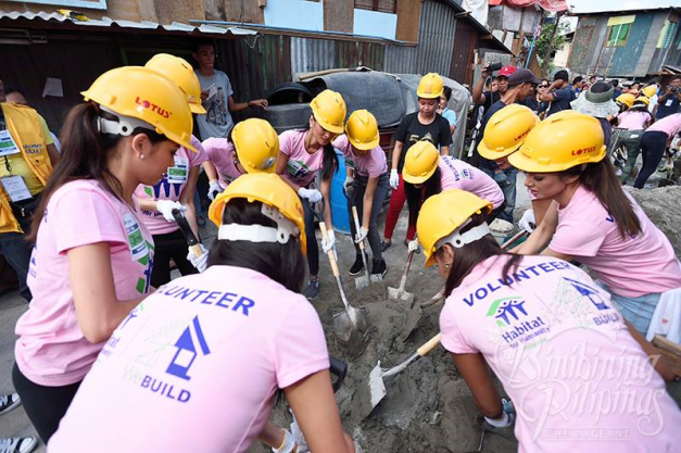 You don't get to see Binibinis mixing cement the way they are doing it above.