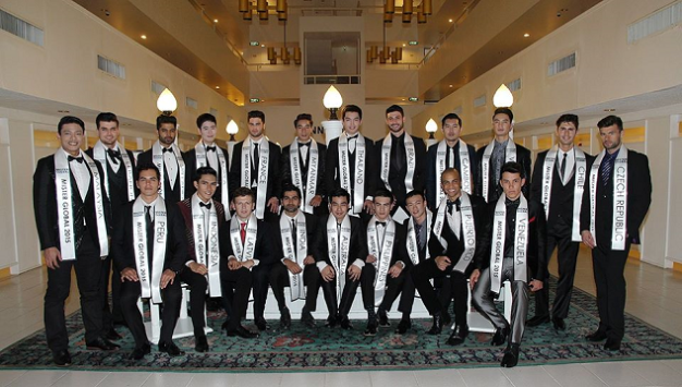 The Twenty-one (21) Official Candidates of Mister Global 2015. Joseph is seated 4th from right.