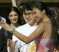 Mafae taking a pic with Superstar Jackie Chan during one of the MW2003 events