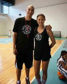 While husband Nic holds a Basketball clinic, Mafae coaches tennis at Belasco Unlmited Skills Academy