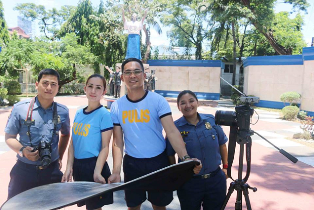 Sofia (2nd from left) shooting part of her environmental video with members of the PNP (Photo credit: Eton Concepcion)