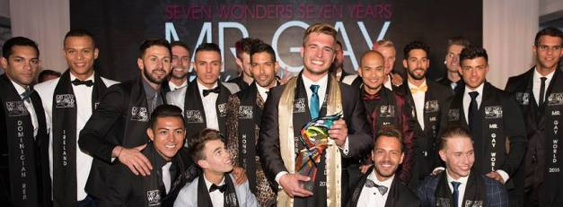 Definitely a top. Klaus Burkart of Germany (with trophy) poses with his fellow candidates after being proclaimed Mr. Gay World 2015 in South Africa