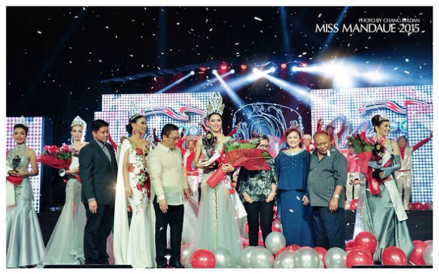 Ena Velasco (center) beams after winning Miss Mandaue 2015