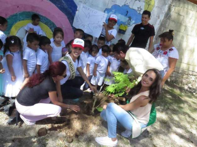 Tree-planting in Tulum, Mexico with some local kids