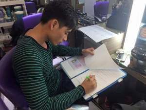 Arcel filling up his application for Mister Model International 2015