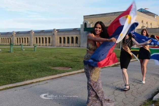 Miss Philippines Ann Colis with the Philippine flag