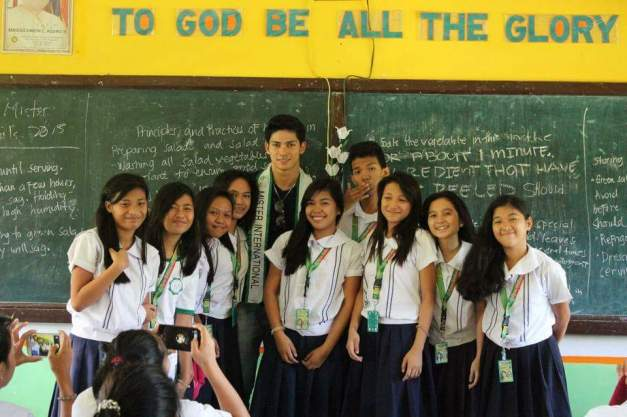 In his old classroom with some students of Talipan National High School