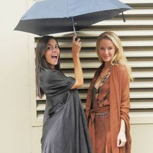 Paulina and Olivia braved the rains just to hop from one show to the next