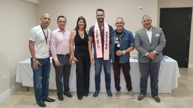 Mister Model International 2014 Victor Zanatta (4th from left) with the organizers led by Luis Trujillo (leftmost)