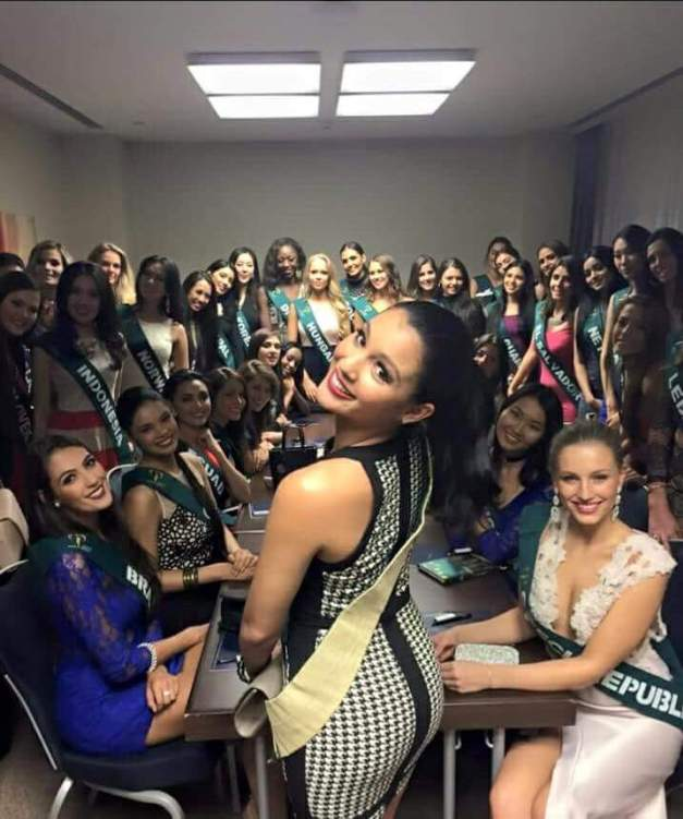 Miss Earth 2014 Jamie Herrell poses with the Miss Earth 2015 candidates during an orientation